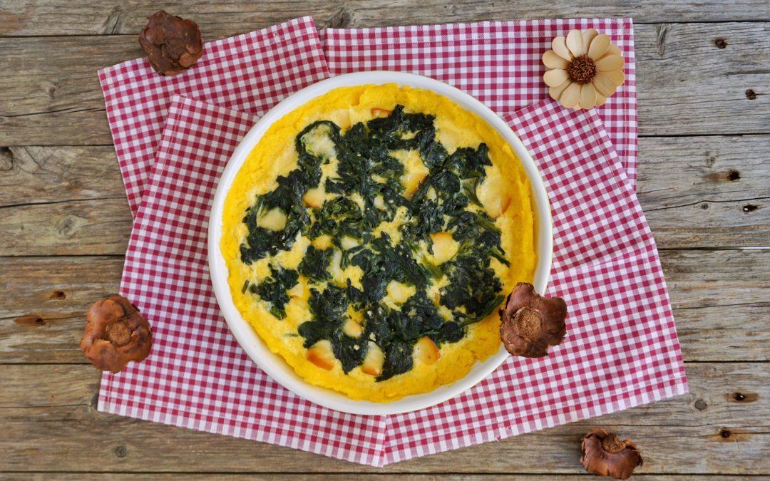 Torta di polenta con spinaci e scamorza affumicata